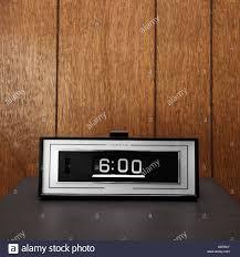 retro wood paneling retro clock set for 6 00 against wood paneling stock photo