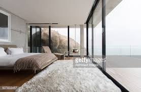 Modern Bedroom Rugs Shag Rug And Glass Walls In Modern Bedroom Stock Photo Getty Images