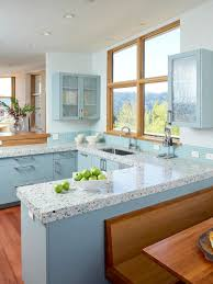 blue and greyish green painted kitchen cabinets light brown dining
