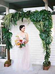 wedding arch leaves picture of a wedding arch decorated with tropical leaves and