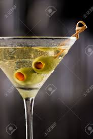 vodka martini dirty vodka martini served on a dark bar garnished with large