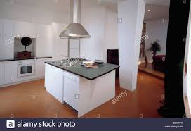 island units for kitchens stainless steel extractor above white island unit with black