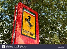 Sign Stands by A Ferrari Sign Stands Outside A Dealdership In Lyndhurst In The