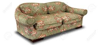 vieux canapé an vintage sofa with a green and floral fabric on an