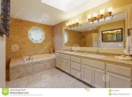 luxury bathroom interior with tile trim and big vanity cabinet