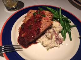 Meatloaf stack with mashed potato and green beans Picture of