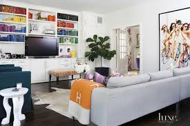 built ins with books arranged by color contemporary living room