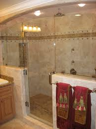 bathroom shower ideas stone floor and stone accent stripe on