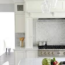 Herringbone Marble Backsplash by Mosaic Marble Herringbone Cooktop Backsplash Design Ideas