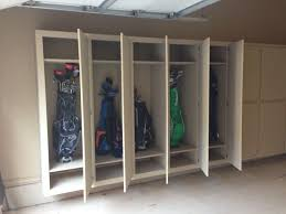 happy little golf clubs all tucked away in garage cabinets yay