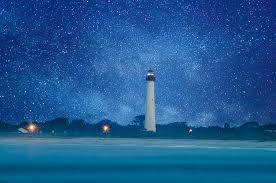 light house at night cape may lighthouse at night photograph by bill cannon