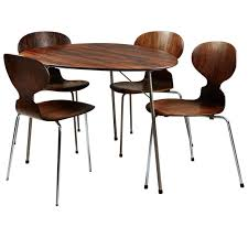 dining table and chairs designed by arne jacobsen for fritz hansen