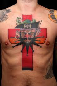 funky men face and old big red cross tattoo on chest