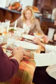 thanksgiving family says prayer before thanksgiving dinner stock