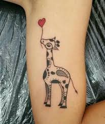 animated giraffe tattoo on half sleeve