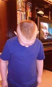 suspension threat outcry over boy u0027s u0027military haircut u0027
