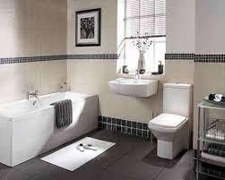 bathroom borders ideas a bathroom with black 1x1 mosaic tiles as border on top