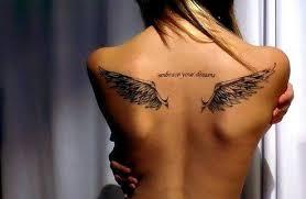 angel wings tattoo on upperback