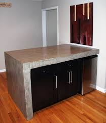 concrete table with a rolling kitchen island underneath album
