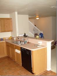how to attach a countertop to a wall without cabinets drywall what s the deal with half walls behind the kitchen
