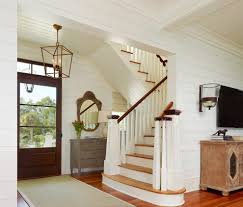 foyer lantern entry tropical with wood carved mirror wood paneling
