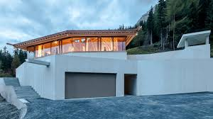 an alpine experiment by sam architects anchors a house on a