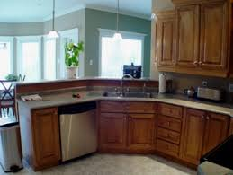 removing kitchen wall cabinets remove a half wall add a whole new look to your kitchen