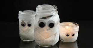 halloween glass jars mummify your mason jars with this spooky halloween craft