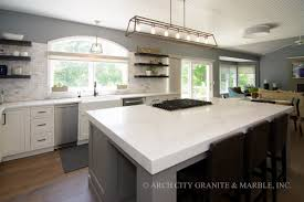 green kitchen cabinets with white countertops the most popular quartz countertop colors in 2021 updated