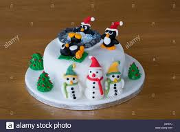 novelty christmas cake decorated with amusing penguins and