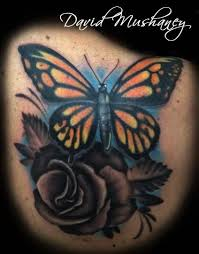 butterfly and rose cover up tattoo by david mushaney tattoos