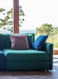 emerald green green sofa against huge windows ikea vallentuna