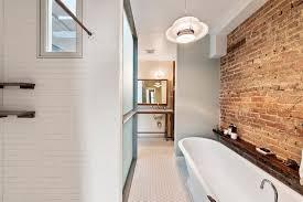 Contemporary Bathroom Wall Sconces Contemporary Master Bathroom With Interior Brick U0026 Pendant Light