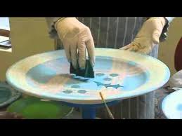 tain pottery decorating the pottery painting a plate