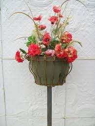 flower baskets wrought iron border column flower baskets