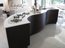 by placing the curved island furniture in the kitchen will add