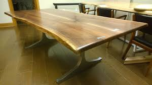 hand crafted custom live edge table with brass or steel bowties by