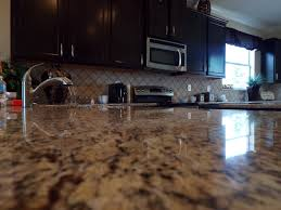 granite countertops sarsaparilla color aristakrat cabinets in
