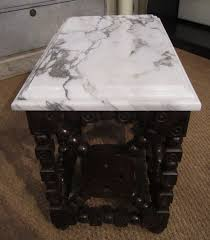 an unusual side table plinth in furniture