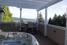 vinyl pergola kit on rooftop patio with scenic mountain views