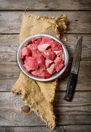 meat cutting table tops cutting raw meat a large knife on wooden table stock image image