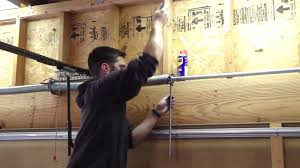 replace spring on garage door how to tighten the garage door spring youtube