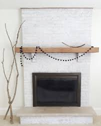 decor white brick fireplace with decorations and wooden planked