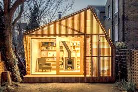 wood studio wsd architecture s tiny writer s studio is a glowing tale