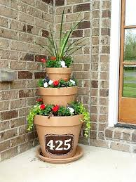 Flower Planter Ideas by 10 Amazing Flower Tower Tipsy Pot Planter Ideas A Cultivated Nest