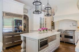 kitchen islands with legs gray kitchen island with carved legs and stainless steel warming