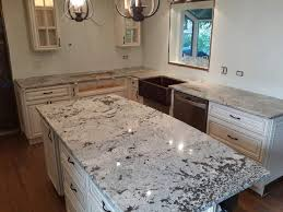 Granite Countertop Kitchen Cabinet Height by Granite Countertop White Cabinet Ideas Metallic Backsplash Tile
