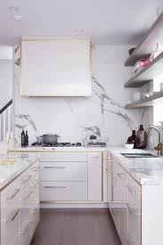 Lacquered Kitchen Cabinets White And Gold Kitchen Features White Lacquered Cabinets With Gold