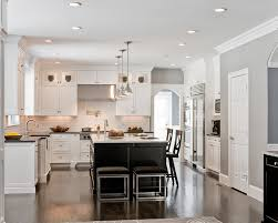 contrasting kitchen dark island with supreme white quartz cream