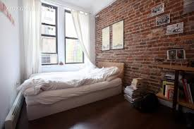 charming studio apartment ideas displaying rustic brick stone wall